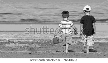stock-photo-two-brothers-walk-along-the-beach-in-a-sunny-day-black-and-white-76513687